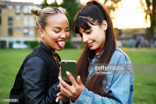 friends taking selfie, sticking tongue out - hipster culture stock pictures, royalty-free photos & images