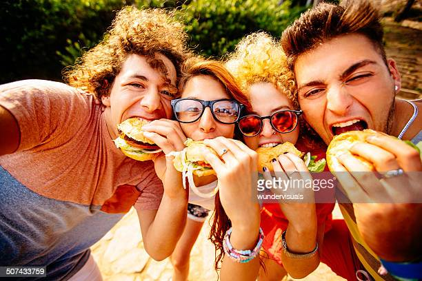 friends taking selfie with hamburgers - hamburger stock pictures, royalty-free photos & images