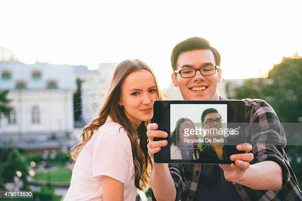 Friends Taking Selfies Outdoors