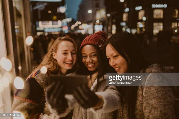 friends taking selfies - warm clothing stock pictures, royalty-free photos & images