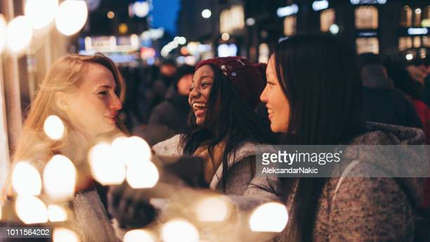 friends taking selfies - christmas scenes stock photos and pictures