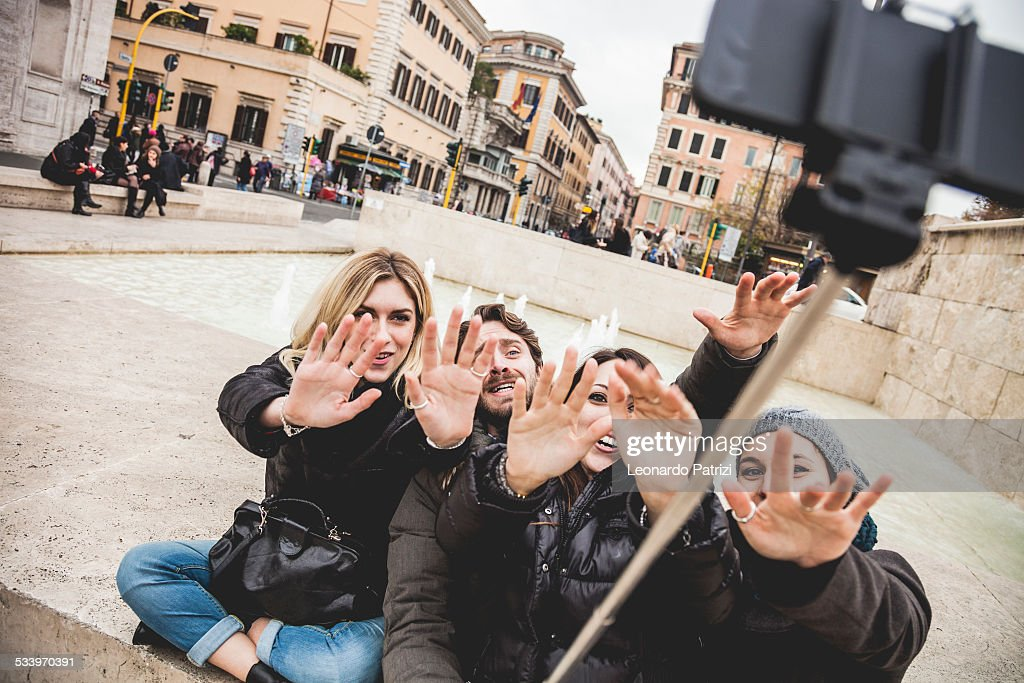 People Using Selfie Sticks : News Photo
