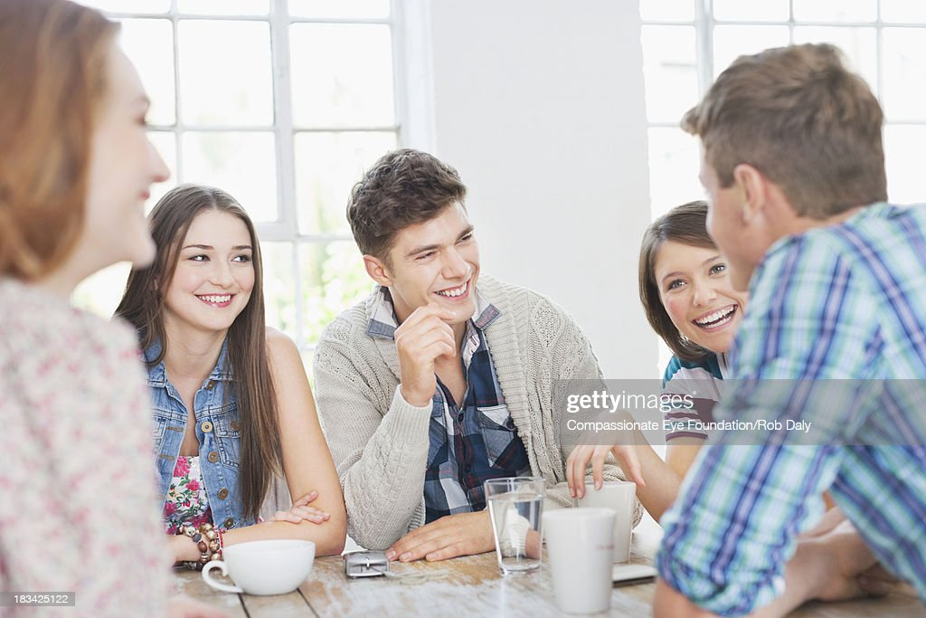 Friends talking and drinking coffee : Stock Photo