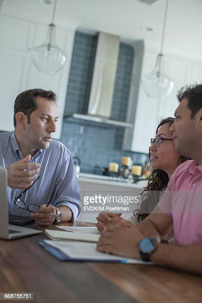 Friends talking at kitchen table