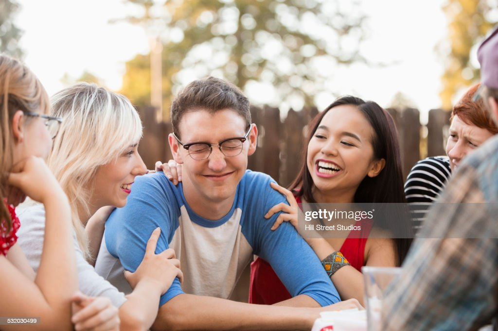 Friends talking at party : Stock Photo
