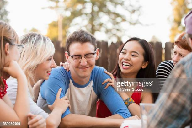 friends talking at party - teasing stock pictures, royalty-free photos & images