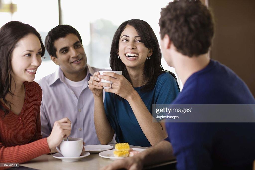Friends talking in cafe : Stock Photo