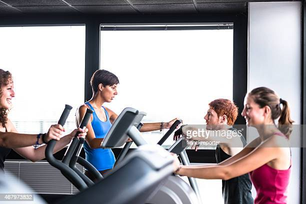 friends talking on the gym treadmill