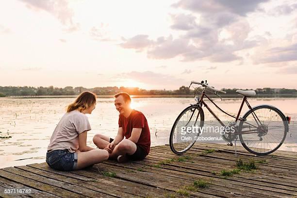 Friends talking on the pier