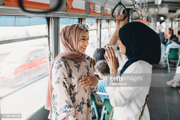 friends talking together inside a bus in the city - syria stock pictures, royalty-free photos & images