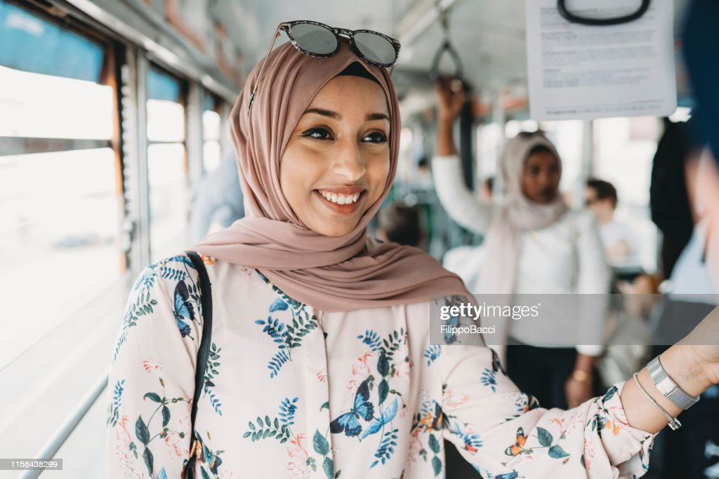 Friends talking together inside a bus in the city : Stock Photo
