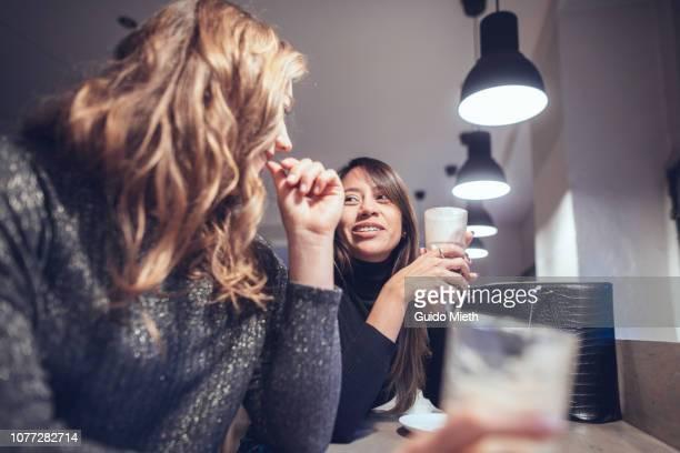 Friends talking while having a coffee break.