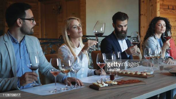 friends tasting wine together - wine tasting stock pictures, royalty-free photos & images