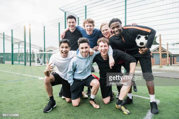 friends team portrait before football kickabout - amateur stock pictures, royalty-free photos & images