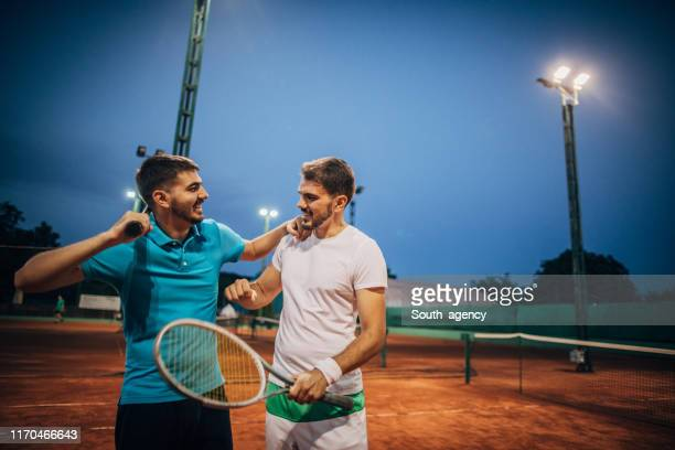 friends tennis players after a game on court - doubles sports competition format stock pictures, royalty-free photos & images