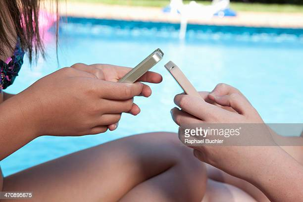 Friends texting on mobile phone