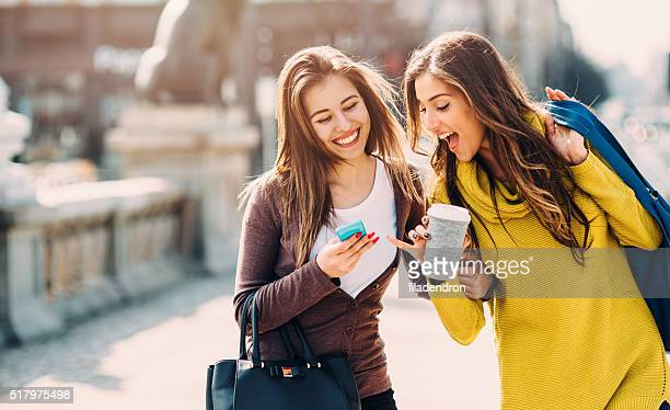 Friends Texting Outside