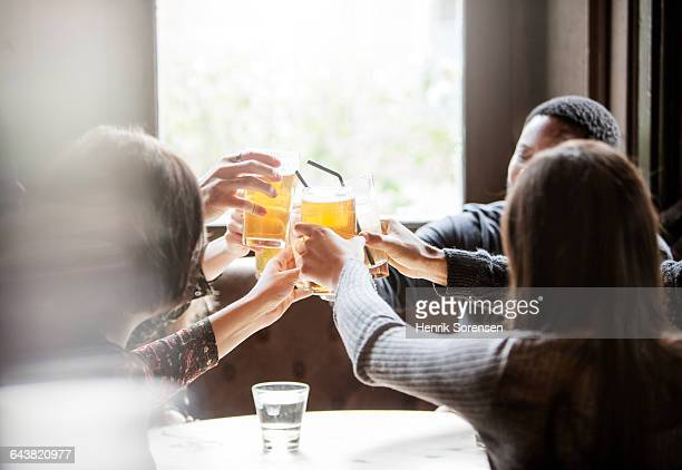 Friends toasting at a pub