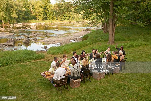friends toasting at an outdoor dinner party