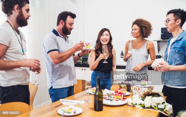 Friends toasting at party.