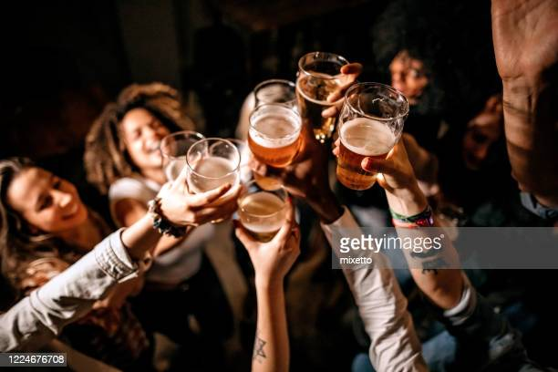 friends toasting at pub - honour stock pictures, royalty-free photos & images