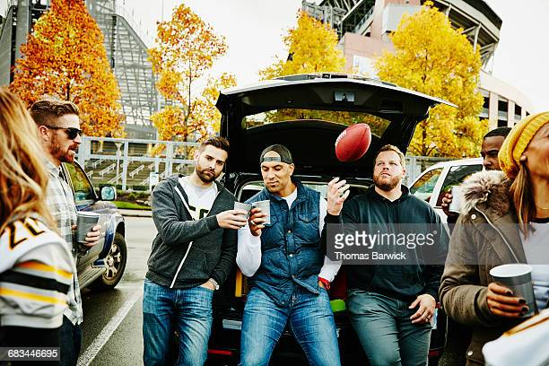friends toasting at tailgating party before game - tailgate party stock pictures, royalty-free photos & images