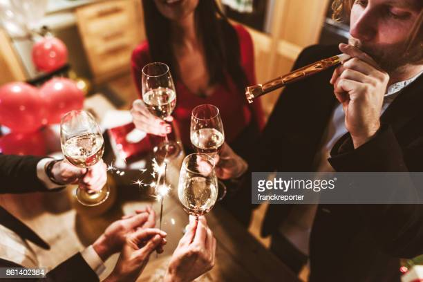 friends toasting at the party for the new year - brindisi capodanno foto e immagini stock