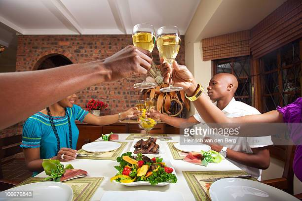 Friends toasting before they eat their meal, KwaZulu-Natal, South Africa