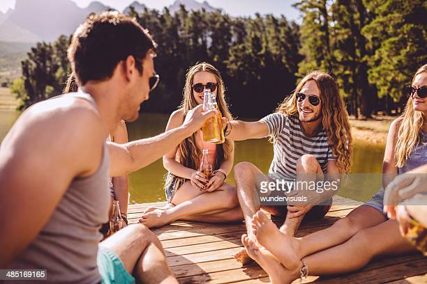 Friends toasting by the lake