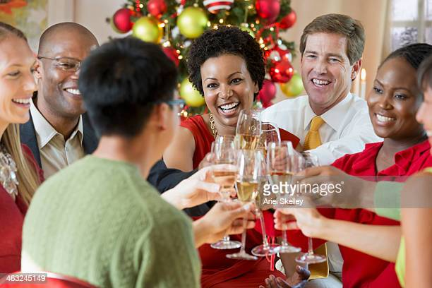 Friends toasting champagne at Christmas dinner