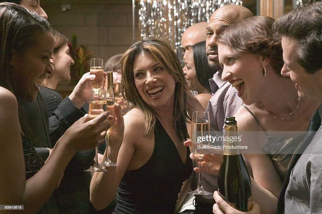 Friends toasting champagne at party : Stock Photo