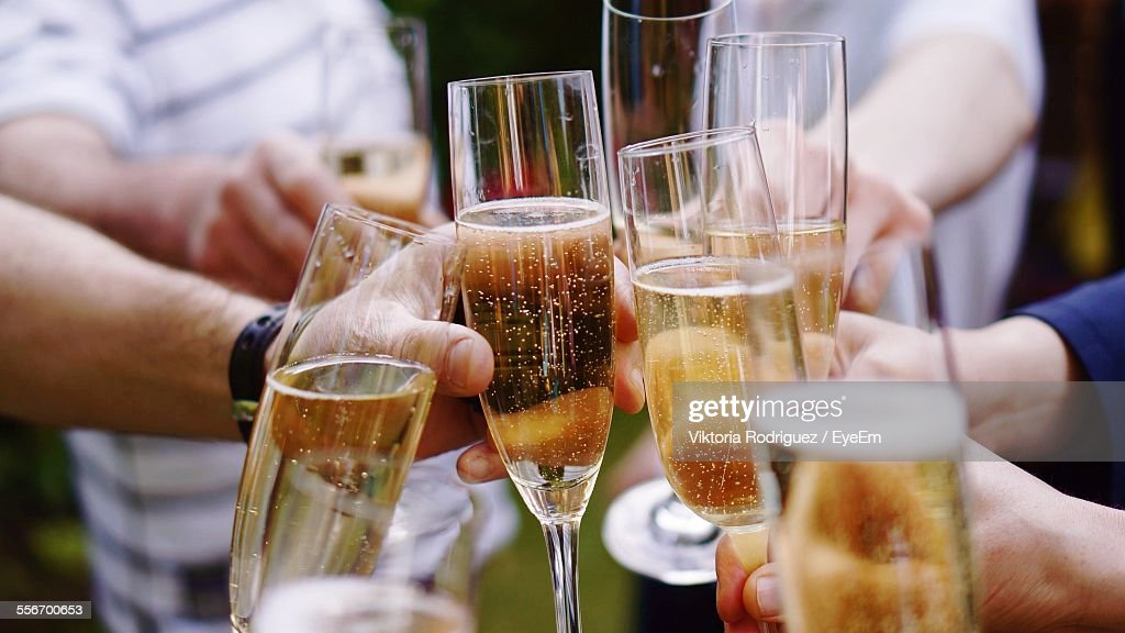 Friends Toasting Champagne Flutes : Stock-Foto