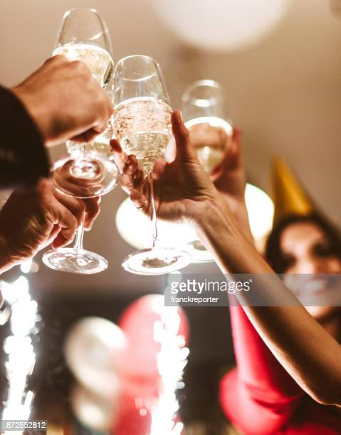 friends toasting champagne for the new year - champagne stock pictures, royalty-free photos & images