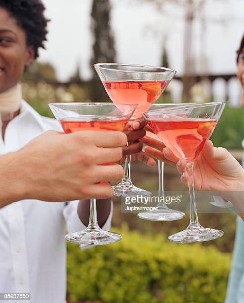 Friends toasting drinks