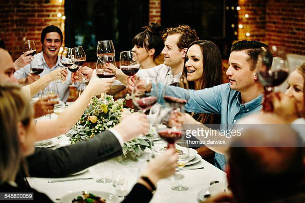 Friends toasting during celebration dinner