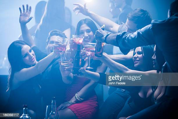 Friends toasting each other in nightclub