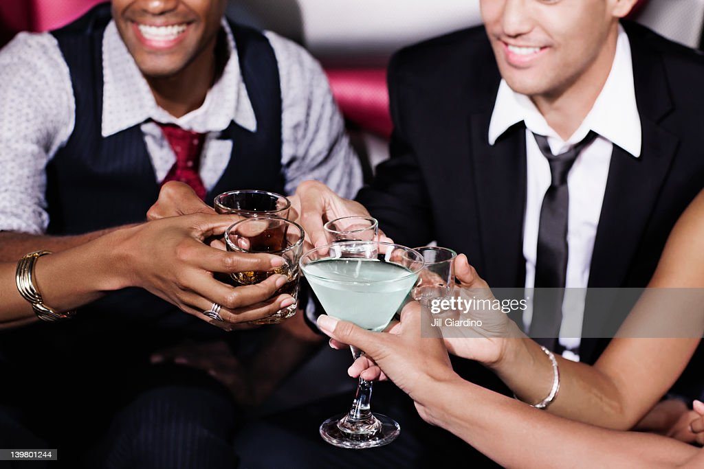 Friends toasting in nightclub : Stock Photo