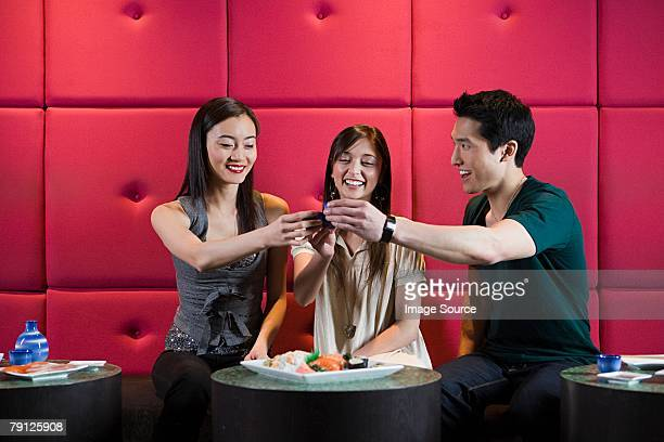 friends toasting - saki stock photos and pictures