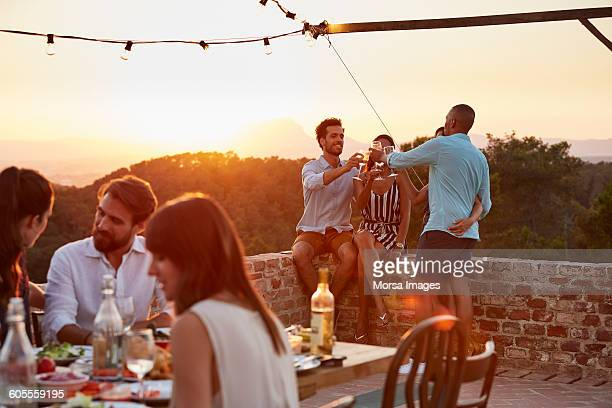 friends toasting wine glasses during dinner party - spanien stock-fotos und bilder