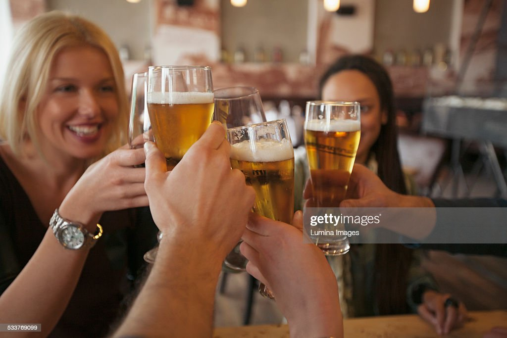 Friends toasting with beer in cafe : Foto stock