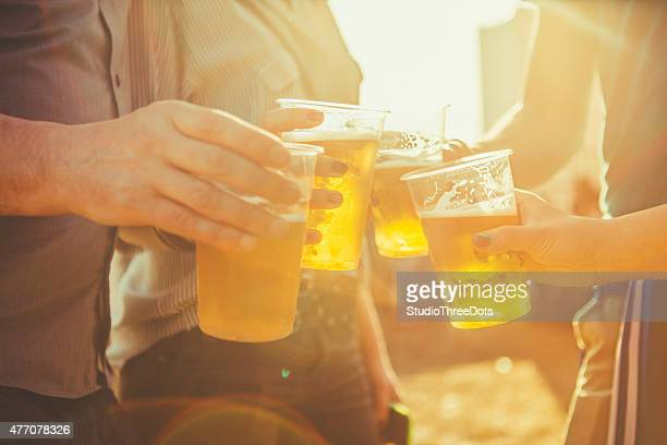friends toasting with beer - disposable cup stock pictures, royalty-free photos & images