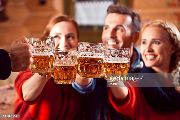 friends toasting with beer - apres ski stock pictures, royalty-free photos & images