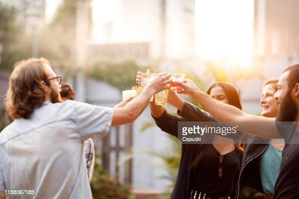 friends toasting with cocktails - cocktail party stock pictures, royalty-free photos & images