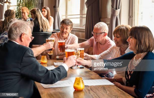 friends together in a british pub - lunch stock pictures, royalty-free photos & images