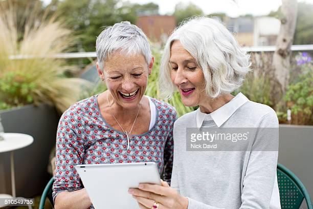 Friends together using tablet