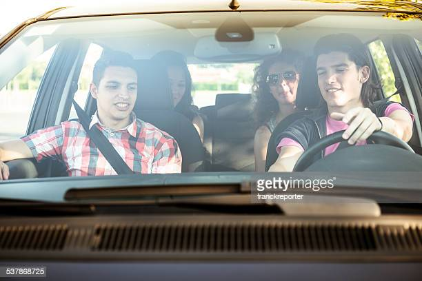 Friends togetherness on the car leaving for vacations