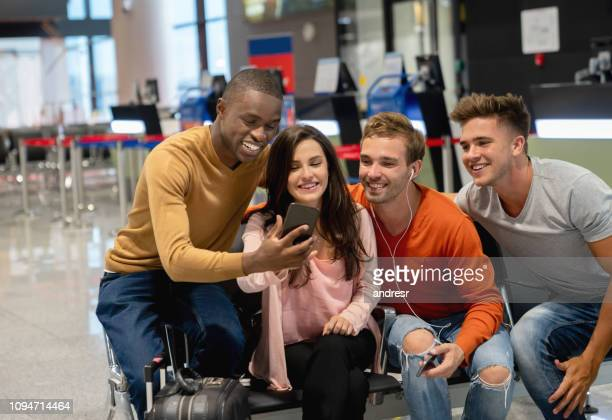 Friends traveling and looking at social media while waiting for boarding