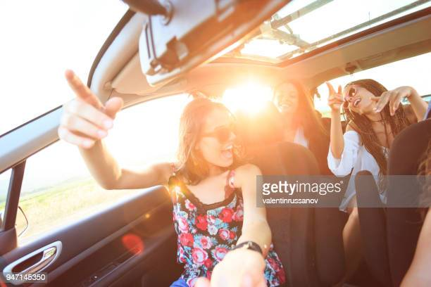 friends traveling and singing - singing stock pictures, royalty-free photos & images
