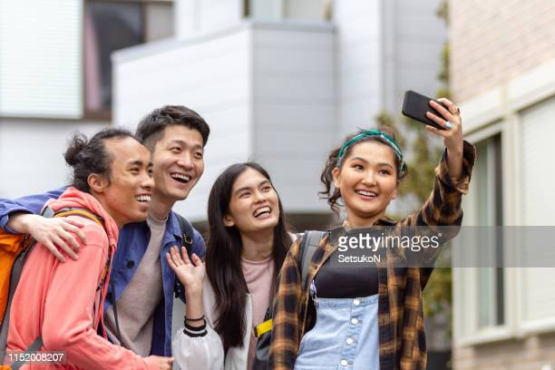 friends traveling in japan, exploring in tokyo - south east asian ethnicity stock pictures, royalty-free photos & images