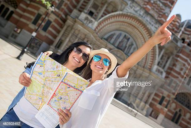 Friends traveling together and holding a map